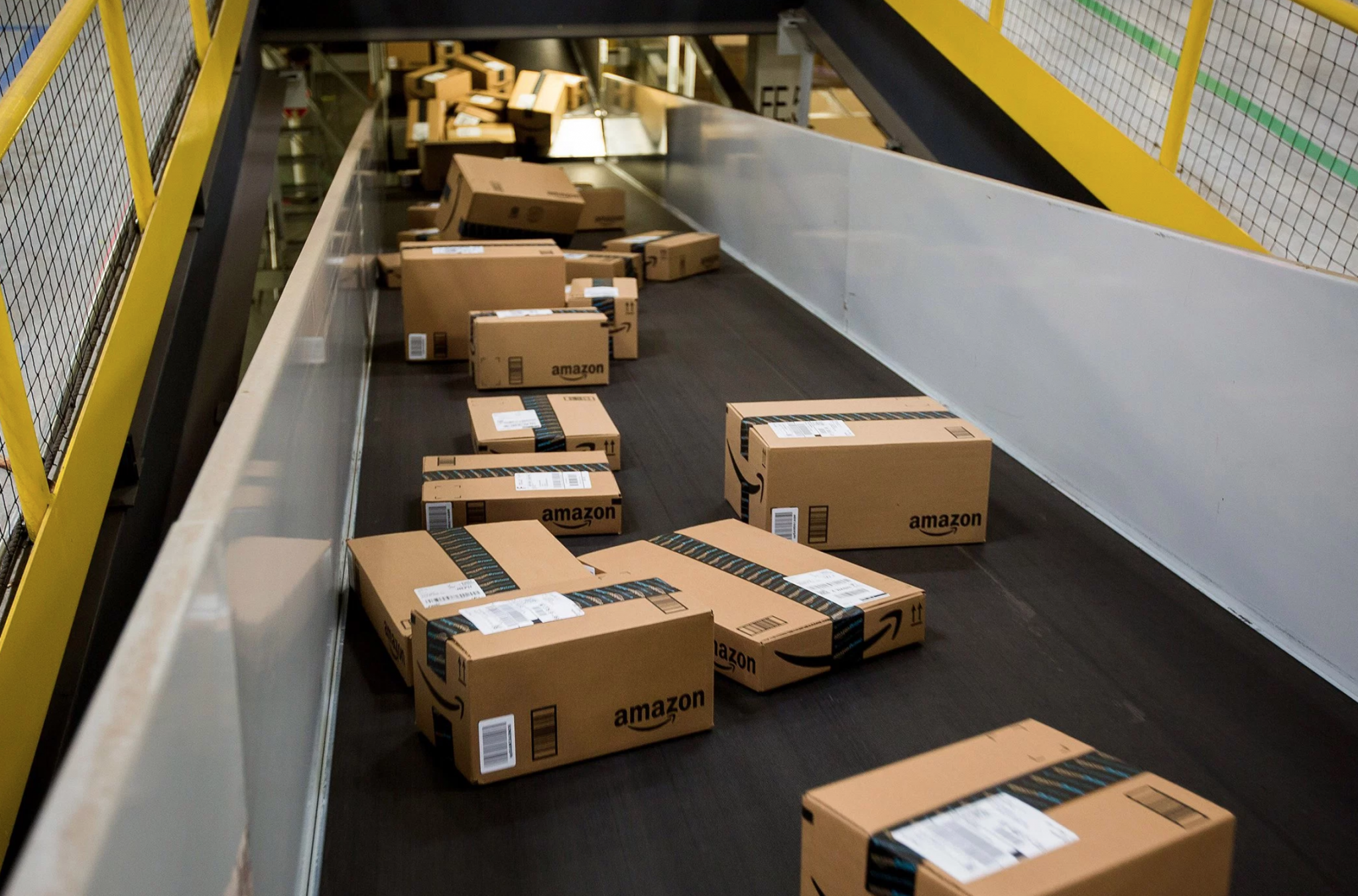 Conveyor belt with Amazon boxes rolling down it